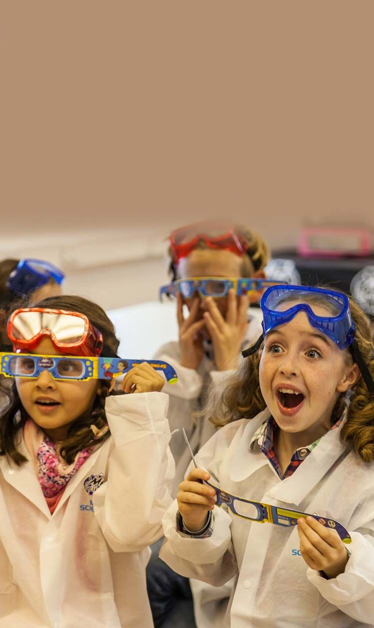 a group of amazed kids wearing diffraction glasses